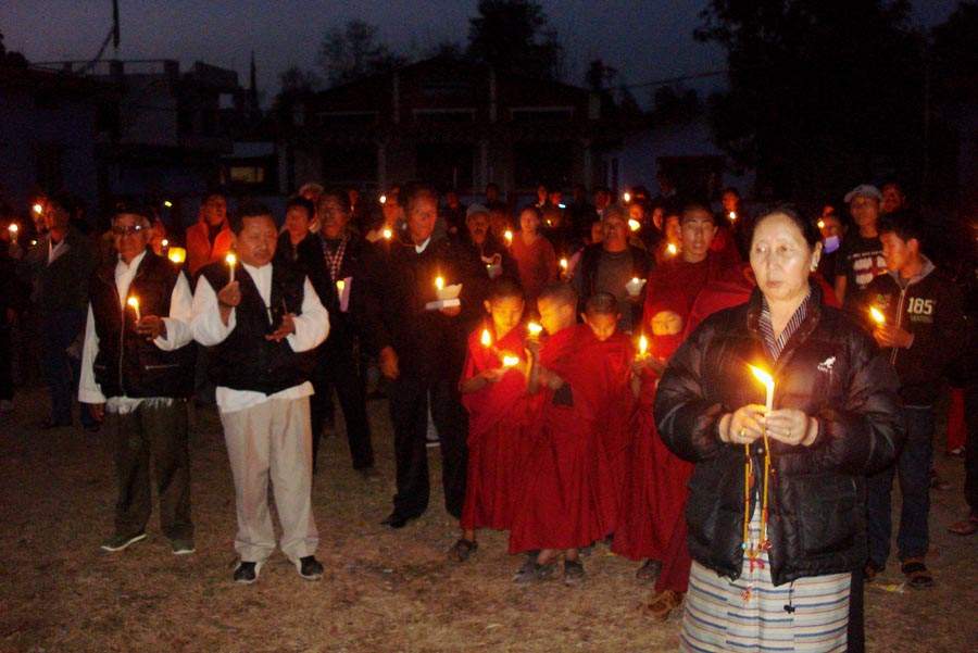 Exile Tibetans hold a candlelight vigil in Paonta Sahib, India