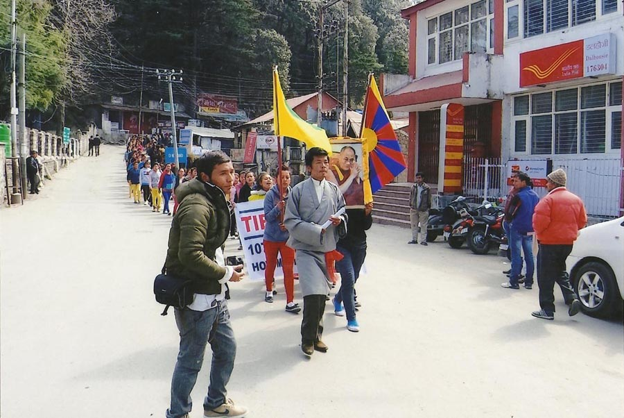 Exile Tibetans march through main bazaar in Dalhousie
