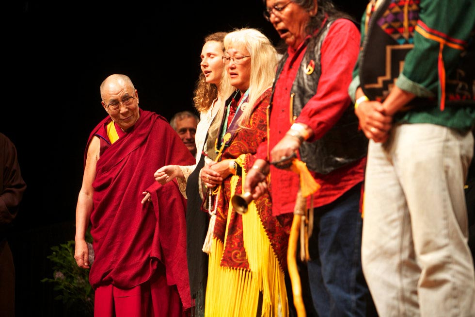 Tibetan spiritual leader the Dalai Lama watches a Native American Cultural performance